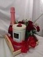 Lovely red rose arrangement with wafer sticks and champaigne hamper.